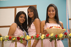 South America, Ecuador, Cuenca.  Teenage beauty queens in annual parade and festival to celebrate founding of Cuenca in 1557.  Cuenca is a UNESCO World Heritage Site.