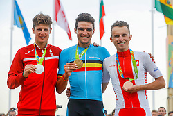Gold medalist Greg van Avermaet of Belgium is flanked by Silver medalist Jakob Fuglsang of Denmark (r) and Bronze medalist Rafal Majka of Poland during the medal ceremony of the Men's Road Race at the Cycling Road event during the Rio 2016 Olympic Games at Fort Copacabana, Rio de Janeiro, Brazil on August 6, 2016. Photo by Giuliano Bevilacqua/ABACAPRESS.COM
