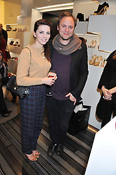 NICHOLAS KIRKWOOD and OPHELIA LOVIBOND at a party to celebrate the launch of a limited edition shoe The Chambord in celebration of Nicholas Kirkwood's partnership with Chambord black raspberry liqueur, held at the Nicholas Kirkwood Boutique, 5 Mount Street, London on 12th December 2012.