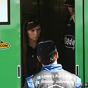 NASCAR Sprint Cup driver Danica Patrick talks with driver Jimmie Johnson in her hauler, prior to her NASCAR Daytona 500 practice session at Daytona International Speedway on Wednesday, February 20, 2013 in Daytona Beach, Florida.  (AP Photo/Alex Menendez)