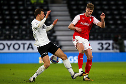 Krystian Bielik of Derby County catches the foot of Michael Smith of Rotherham United - Mandatory by-line: Ryan Crockett/JMP - 16/01/2021 - FOOTBALL - Pride Park Stadium - Derby, England - Derby County v Rotherham United - Sky Bet Championship