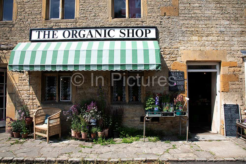 Stow on the Wold in The Cotswolds, United Kingdom. Stow-on-the-Wold is a small market town and civil parish in Gloucestershire, England. The town was founded as a planned market place by Norman lords, to take advantage of trade on the converging roads. The Cotswolds is an area in south central England. The area is defined by the bedrock of limestone that is quarried for the golden coloured Cotswold stone. It contains unique features derived from the use of this mineral; the predominantly rural landscape contains stone-built villages and historical towns.