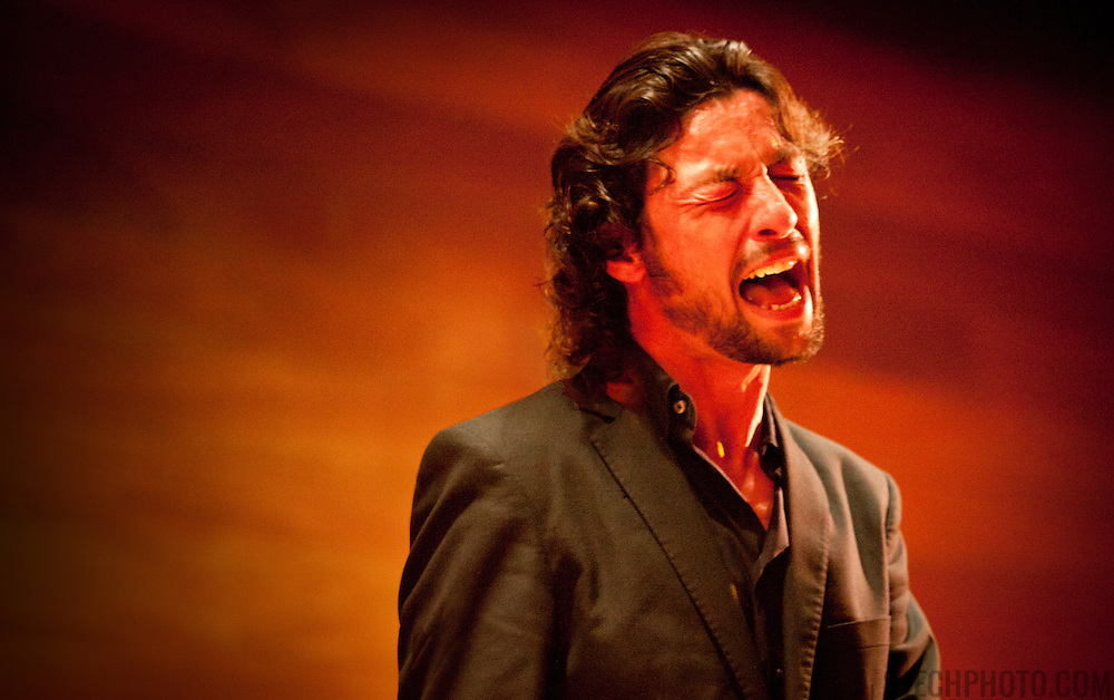 A flamenco singer on stage performing in Almeria, Spain.