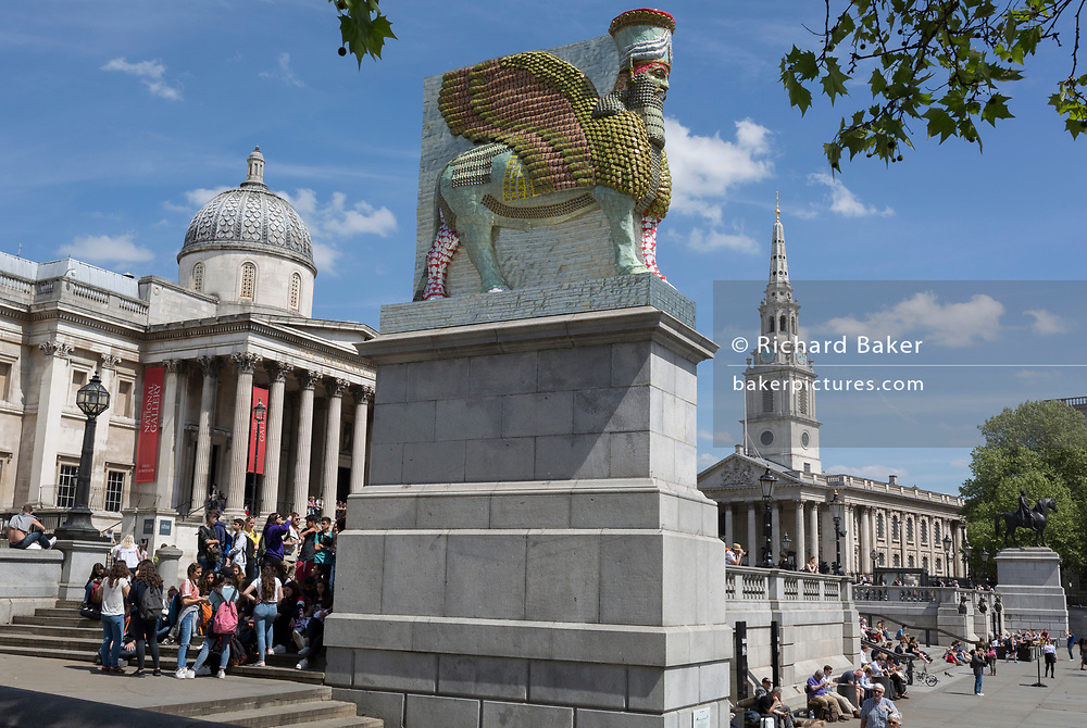 The 12th Fourth Plinth commission by the Mayor of London  artwork entitled 'The Invisible Enemy Should Not Exist' by the artist Michael Rakowitz, in Trafalgar Square, on 9th May 2018, in London, England. Started in 2006, the sculpture recreates over 7,000 archaeological artefacts looted from the Iraq Museum during the war there or destroyed elsewhere. Oneof these was Lamassu, a winged deity which guarded Nergal Gate at the entrance to the ancient city Assyrian city of Nineveh (modern-day Mosul, Iraq) which was destroyed by ISIS in 2015. The Lamassu, which had the same footprint as the Fourth Plinth is made of empty Iraqi date syrup cans, representative of a once-renowned industry.