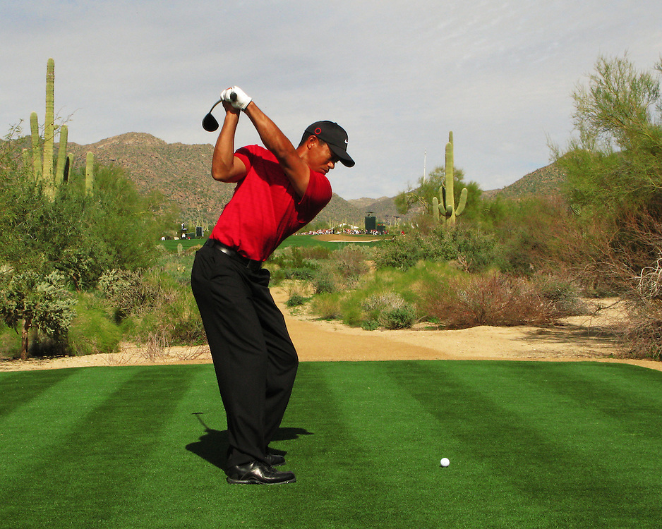 Tiger Woods at the top of his back swing on the 10th tee of the Gallery Course at Dove Mountain, photographed in Marana, Arizona, February, 2008. Photograph by Darren Carroll.