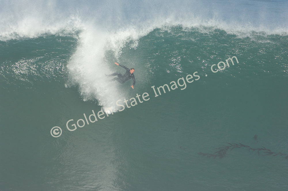 Surfer goes over the falls, 3 of 4 frames.
