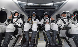 NASA astronauts Shannon Walker, left, Victor Glover, Mike Hopkins, and Japan Aerospace Exploration Agency (JAXA) astronaut Soichi Noguchi, right are seen inside the SpaceX Crew Dragon Resilience spacecraft onboard the SpaceX GO Navigator recovery ship shortly after having landed in the Gulf of Mexico off the coast of Panama City, Florida, Sunday, May 2, 2021. NASA's SpaceX Crew-1 mission was the first crew rotation flight of the SpaceX Crew Dragon spacecraft and Falcon 9 rocket with astronauts to the International Space Station as part of the agency's Commercial Crew Program. Photo by Bill Ingalls / NASA via CNP /ABACAPRESS.COM