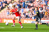 Cameron McGeehan of Barnsley (8) and Greg Docherty of Shrewsbury Town (8) in action during the EFL Sky Bet League 1 match between Barnsley and Shrewsbury Town at Oakwell, Barnsley, England on 19 April 2019.