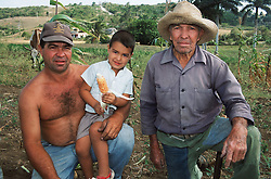 Family group with grandfather; father and son on a farm near Jibacoa; Cuba,