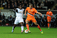 Wilfried Bony of Swansea city is challenged by Oriol Romeu of Valencia (r). UEFA Europa league match, Swansea city v Valencia at the Liberty Stadium in Swansea on Thursday 28th November 2013. pic by Andrew Orchard, Andrew Orchard sports photography,