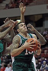 20 November 2013:  Emmy Andujar struggles in traffic near the hoop during an NCAA Non-Conference mens basketball game between theJaspers of Manhattan and the Illinois State Redbirds in Redbird Arena, Normal IL