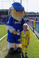 Haydon the Womble with Bristol Rovers mascot who handed him a stuffed womble teddy during the EFL Sky Bet League 1 match between AFC Wimbledon and Bristol Rovers at the Cherry Red Records Stadium, Kingston, England on 19 April 2019.