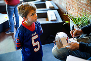SHOT 12/10/17 1:02:24 PM - Former Buffalo Bills wide receiver and Hall of Fame player Andre Reed signs autographs and meets with fans at LoDo's Bar and Grill in Denver, Co. as the Buffalo Bills played the Indianapolis Colts that Sunday. Reed played wide receiver in the National Football League for 16 seasons, 15 with the Buffalo Bills and one with the Washington Redskins. (Photo by Marc Piscotty / © 2017)