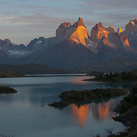 The Horns of Paine reflect in Lake Pehoe in Torres del Paine National Park, Chile.