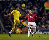 Photo: Jed Wee.<br /> Manchester United v Villarreal. UEFA Champions League.<br /> 22/11/2005.<br /> <br /> Villarreal's Jose Mari (L) tries to challenge Manchester United's John O'Shea.