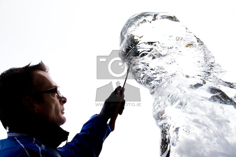 Repro Free: 06/11/2012 .Sculpters, Andrew Clancy is pictured creating a giant ice sculpture at the launch of Ireland's largest ice rink, I-Skate@The RDS running from November 16th to January 13th. Pic Andres Poveda..Measuring 1,000 square metres, I-Skate will be the largest rink operating in Ireland this year. Because the rink is so large it is expected that, despite a projected attendance of 100,000+, at all times skaters will have plenty of room to enjoy themselves.?.For those looking for a more stationary form of entertainment ice sculptures and ice sculpting demonstrations will be held on the 16th & 17th of November and the 8th & 9th of December. To book tickets, find out about opening times or the facilities available to families and junior skaters or even to book yourself a hockey match just visit www.iskate.ie .?.