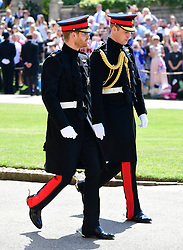Prince Harry (left) and The Duke of Cambridge (right) arrive at St George's Chapel at Windsor Castle for his wedding.