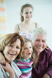 Portrait of grandparents and granddaughters, smiling