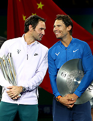 SHANGHAI, Oct. 15, 2017  Winner Roger Federer (L) of Switzerland talks to runner-up Rafael Nadal of Spain in the victory ceremony of 2017 ATP Shanghai Masters tennis tournament in Shanghai, east China, on Oct. 15, 2017. (Credit Image: © Fan Jun/Xinhua via ZUMA Wire)