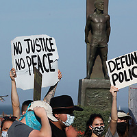 Peaceful protest march and rally against racism and over the police killing of George Floyd and other Black Americans at the hands of police.  (Shmuel Thaler — Santa Cruz Sentinel)