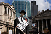 Protesters gather to deomontstrate against various issues outside the Bank of England in the heart of the City of London. Issues such as anti climate change, capitalism and those against the credit crisis were the main points of the day. Bankers being a particular target of protest. A dummy of a banker wearing a suit and traditional bowler hat hanged by a rope around it's neck.