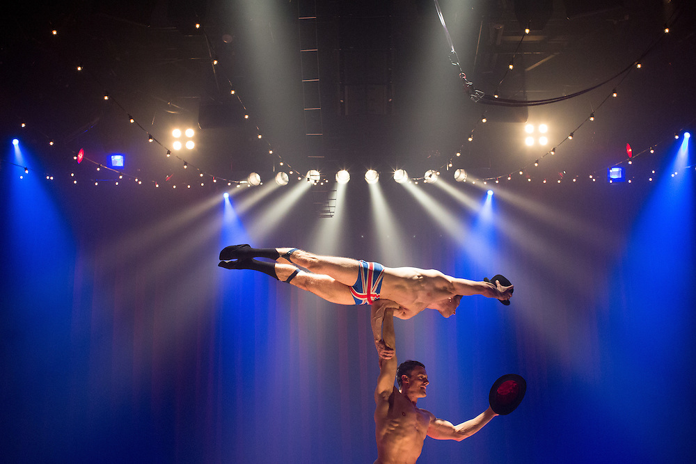 """The English Gents, acrobats Denis Lock, bottom, and Hamish McCann, are pictured on stage during a nightly performance of """"La Soirée,"""" which combines circus and burlesque acts, at the Union Square Theater on East 17th Street in Manhattan, N.Y., Friday, Dec. 6, 2013. Credit: Claudio Papapietro for The Wall Street Journal<br /> <br /> NYCIRCUS"""