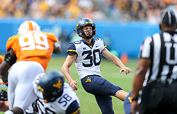 Sep 1, 2018; Charlotte, NC, USA; West Virginia Mountaineers place kicker Evan Staley (30) kicks a field goal during the first quarter against the Tennessee Volunteers at Bank of America Stadium. Mandatory Credit: Ben Queen-USA TODAY Sports