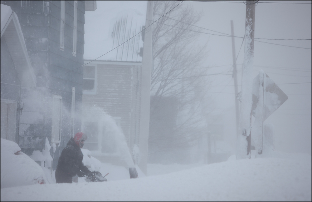 Clearing 1-2 feet of snow on the Upper Peninsula of Michigan during a Blizzard.