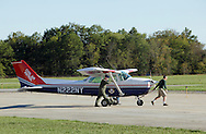 Montgomery, New York - Two members of the Civil Air Patrol move a Civil Air Patrol airplane at Orange County Airport on Oct. 2, 2010.