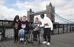 Winners of the men and women's 2018 Virgin Money London Marathon race Kenya's Eliud Kipchoge (right) and Kenya's Vivian Cheruiyot (left) with the winners of the men and women's wheelchair race Great Britain's David Weir (second left) and Australia's Madison de Rozario during a photocall outside Tower Bridge, London.