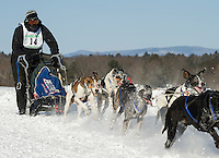 Claude Bellerive of Charette, Quebec leads his team (sponsors EJ Prescott and Shea Concrete) towards the finish area during the Open Class race at the 86th annual Laconia World Championship Sled Dog Races Friday afternoon.  (Karen Bobotas/for the Laconia Daily Sun)