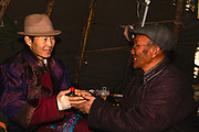 Tsaatan men exchanging snuff bottles upon greeting in a teepee, Khovsgol Province, Mongolia