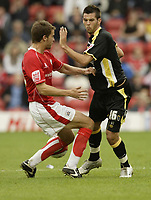 Photo: Aidan Ellis.<br /> Barnsley v Cardiff City. Coca Cola Championship. 29/09/2007.<br /> Cardiff's Joe Ledley loses out to Barnsley's Paul Reid
