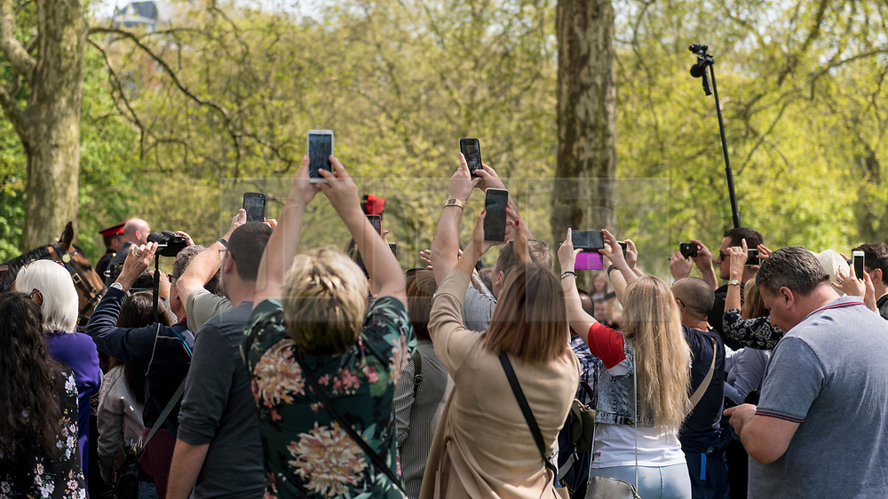 © Licensed to London News Pictures. 22/04/2019. LONDON, UK.  Members of the public try to take photos of Princess Anne departing after the King's Troop Royal Horse Artillery took part in a 41 gun salute in Hyde Park to mark the 93rd birthday of Her Majesty The Queen.  Six First Wold War-era 13-pounder Field Guns are used to fire blank artillery rounds..  Photo credit: Stephen Chung/LNP