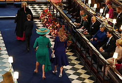 Sarah Ferguson and Princess Beatrice arrive at the wedding of Princess Eugenie to Jack Brooksbank at St George's Chapel in Windsor Castle.