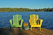 Muskoka chairs  on dock at Star Lake<br /> Whiteshell Provincial PArk<br /> Manitoba<br /> Canada