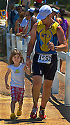Memphis in May race with daughter holding fathers hand as they get ready to cross the finish line. Millington, TN