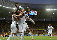 Fotball<br /> VM 2014<br /> Hellas v Elfenbenskysten<br /> 24.06.2014<br /> Foto: imago/Digitalsport<br /> NORWAY ONLY<br /> <br /> Greece s Andreas Samaris (C, front) celebrates for a goal with his teammates during a Group C match between Greece and Cote d Ivoire of 2014 FIFA World Cup at the Estadio Castelao Stadium in Fortaleza, Brazil, June 24, 2014.