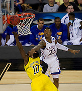 Tim Hardaway Jr. (10 of the University of Michigan Wolverines drives to the basket against the University of Kansas Jayhawks during the NCAA South Regionals at Cowboys Stadium in Arlington on Friday, March 29, 2013. (Cooper Neill/The Dallas Morning News)