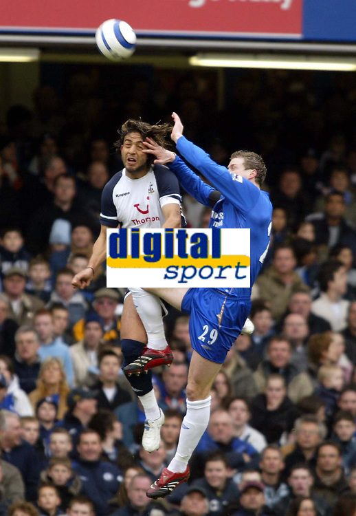 Photo: Chris Ratcliffe.<br />Chelsea v Tottenham Hotspur. The Barclays Premiership. 11/03/2006.<br />Mido (L) of Spurs competes with Robert Huth for the ball.