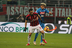 January 26, 2019 - Milano, Italy, Italy - Milano, Lombardia, Italy, 2019-01-26,San siro stadium, Serie A football match AC Milan - SSC Napoli in pictures Kevin Malcuit competition the ball with Hakan calhanoglu (Antonio Balasco - Pacific Press) (Credit Image: © Antonio Balasco/Pacific Press via ZUMA Wire)