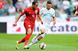Andros Townsend of England vs. Milivoje Novakovic of Slovenia during the EURO 2016 Qualifier Group E match between Slovenia and England at SRC Stozice on June 14, 2015 in Ljubljana, Slovenia. Photo by Mario Horvat / Sportida