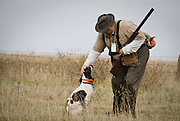 """Jim Dodrill in a moment of affection with his dog """"Lady"""" while pheasant hunting at Quail Point Hunting Preserve, Zamora, California"""
