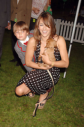 LIZ HURLEY and her son DAMIAN at Macmillan Dog Day in aid of Macmillan Cancer Support, held at Royal Hospital Chelsea, London on 3rd July 2007.<br />