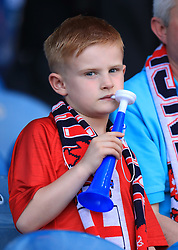 An England fan on a vuvuzela during the International Friendly match at Elland Road, Leeds.