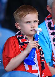 An England fan on a vuvuzela during the International Friendly match at Elland Road, Leeds.