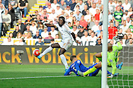 Bafetimbi Gomis of Swansea City spins around in the box and tries to beat Everton's John Stones and goalkeeper Tim Howard but is denied a goal in the second half.<br /> Barclays Premier League match, Swansea city v Everton at the Liberty Stadium in Swansea, South Wales on Saturday 19th September 2015.<br /> pic by Phil Rees, Andrew Orchard sports photography.