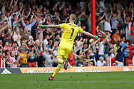 Brentford Goalkeeper Daniel Bentley (1) celebrates a goal from Brentford Midfielder Florian Jozefzoon (7) during the EFL Sky Bet Championship match between Brentford and Queens Park Rangers at Griffin Park, London, England on 21 April 2018. Picture by Andy Walter.