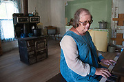Jaye D. Christensen plays the piano at the Ryburn House at Bannack State Park.
