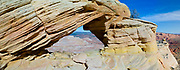 """View of Top Rock Arch, which sits above the beautiful geological formation known as """"The Wave."""" North Coyote Buttes, Vermillion Cliffs National Monument, Arizona."""
